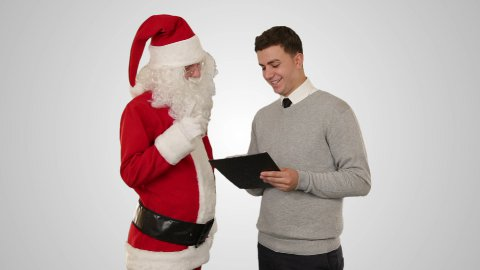 Santa Claus and Young Businessman against white - stock footage
