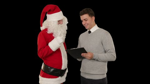 Santa Claus and Young Businessman against black - stock footage