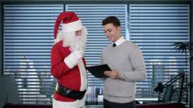 Santa Claus and Young Businessman in a modern office - motion graphic
