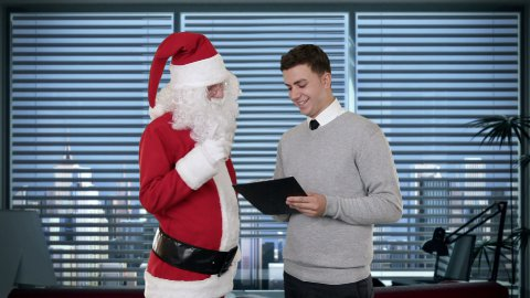 Santa Claus and Young Businessman in a modern office - stock footage