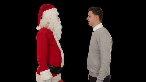 Young Businessman receiving a present from Santa Claus, shaking hands, against black - stock footage