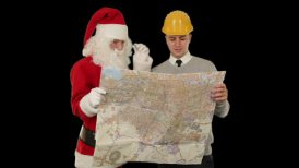 Santa Claus with a Young Architect reading a map, against black - motion graphic