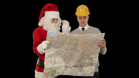Santa Claus with a Young Architect reading a map, against black - stock footage