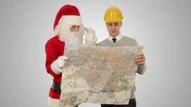 Santa Claus with a Young Architect reading a map, against white