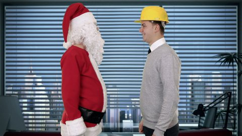 Santa Claus and Young Architect in a modern office, shaking hands and looking at camera - stock footage