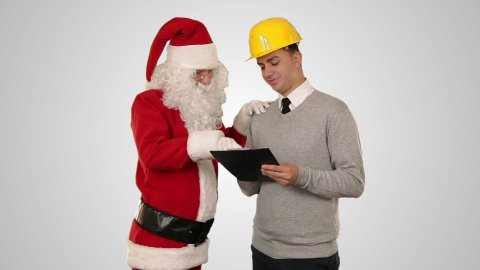 Santa Claus and Young Architect against white - stock footage