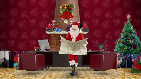 Santa Claus reading a map in his modern Christmas Office - stock footage