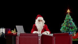 Santa Claus talking, time-lapse, against black - motion graphic