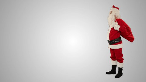 Santa Claus shaking a bell with space for text, against white - stock footage