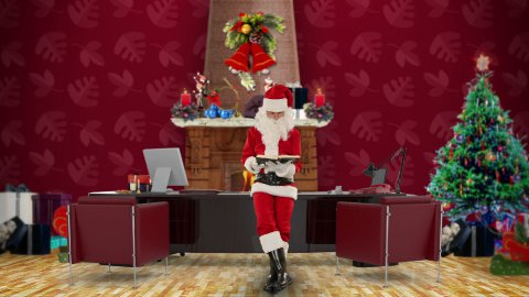 Santa Claus reading a book in his modern Christmas Office - stock footage