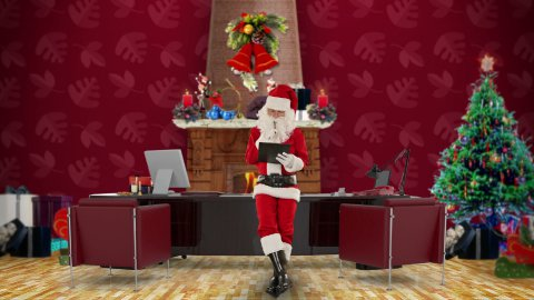 Santa Claus taking notes on a clipboard in his modern Christmas Office - stock footage