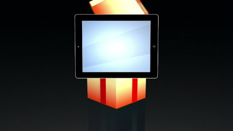 Gift box opening lid to present a tablet, against black - stock footage