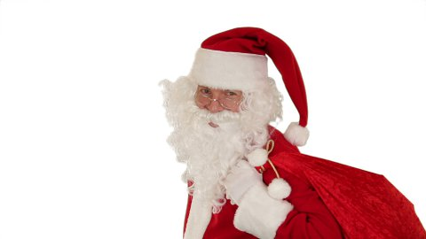 Santa Claus carrying his bag, looks at the camera and winks, white - stock footage