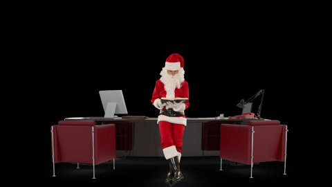 Santa Claus reading a book in his modern Christmas Office, against black - stock footage
