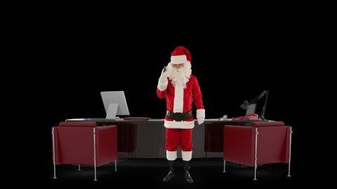 Santa Claus talking on mobile in his modern Christmas Office, against black - stock footage
