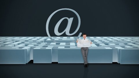 Businessman with Map trying to find his way in a Maze with Internet Mail Sign, dark room - stock footage