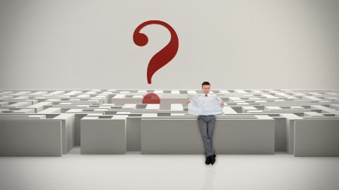 Businessman with Map trying to find his way in a Maze with Question Mark - stock footage