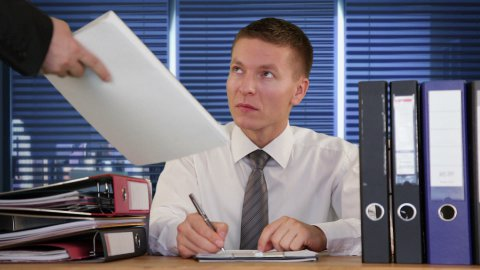 Exhausted Collar Worker receiving more Work and getting to sleep - stock footage
