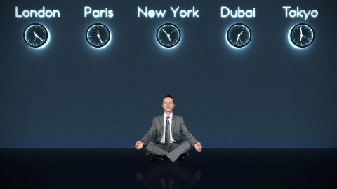 Businessman Meditating with World Clocks on Background in Dark Room - stock footage