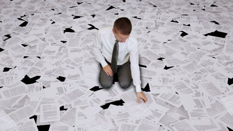 Businessman nightmare, surrounded by bills - stock footage