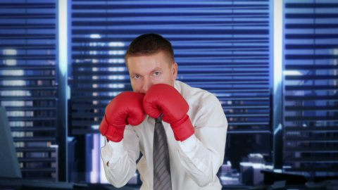 Businessman Boxing with City Skyline on the background - stock footage
