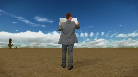 Businessman with Map in Desert with Time Lapse Clouds, back view - stock footage