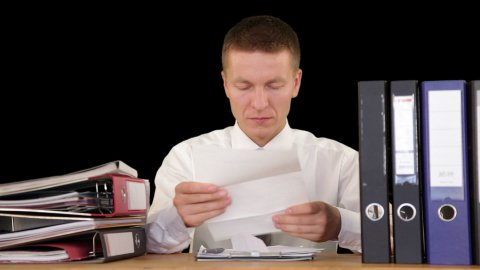 Businessman receiving letters and getting fired, against black 2 - stock footage