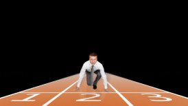 Businessman getting ready for sprint race against black