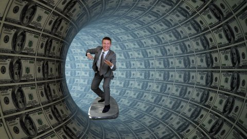 Businessman Surfing inside a Tube made of US Dollars - stock footage