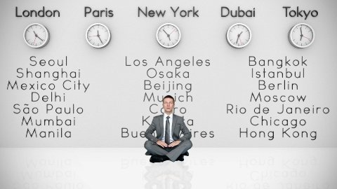 Businessman Meditating with World Clocks and Big Cities on Background - stock footage