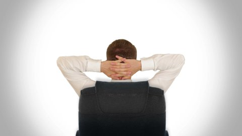 Businessman Relaxing, against white - stock footage