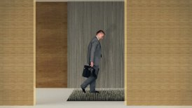 Businessman walking on nails, caution in business concept - motion graphic