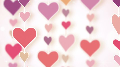 montage of dangling pink hearts - stock footage