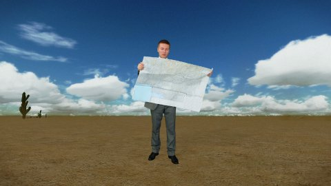 Businessman with Map in Desert with Time Lapse Clouds - stock footage