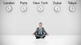 Businessman Meditating with World Clocks on Background - motion graphic