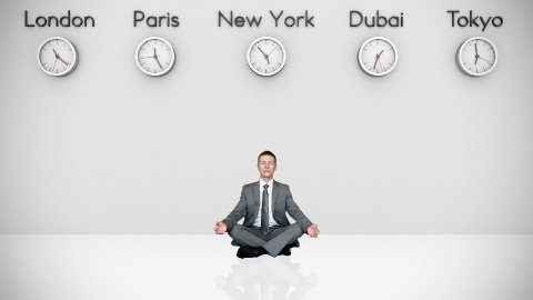 Businessman Meditating with World Clocks on Background - stock footage