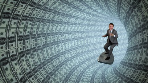 Businessman Surfing inside a Tube of US Dollars - stock footage
