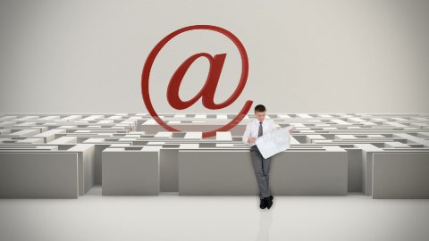 Businessman with Map trying to find his way in a Maze with Internet Mail Sign - stock footage