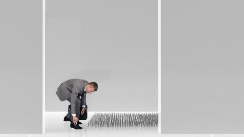 Businessman walking on nails in a white room, caution in business concept - stock footage
