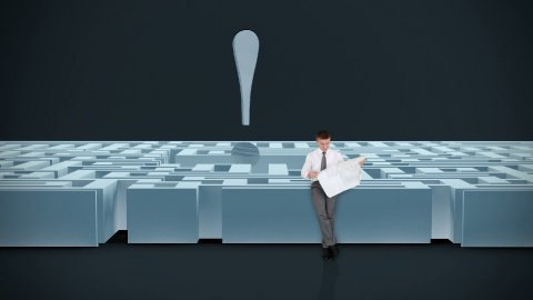 Businessman with Map trying to find his way in a Maze with Exclamation Sign  - stock footage