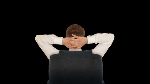 Businessman Relaxing, against black - stock footage
