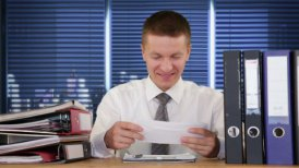 Businessman receiving letters and smiling - motion graphic