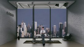 Young Lawyer Reading in Office Room with City Skyline in the Background
