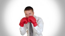 Businessman Boxing against white - motion graphic