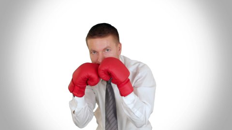Businessman Boxing against white - stock footage