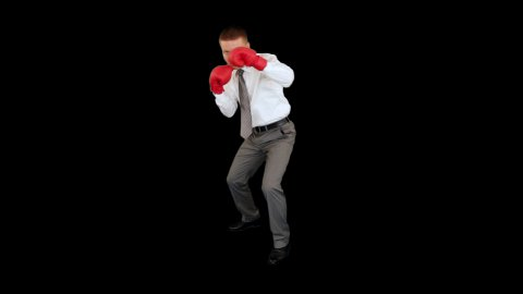 Businessman Boxing, full length against black - stock footage