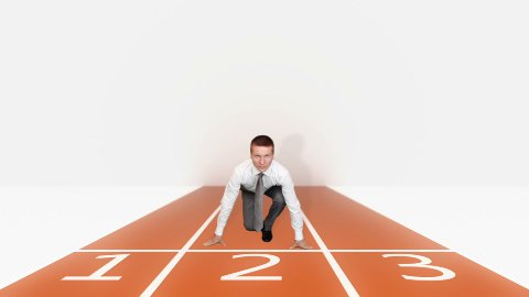 Businessman getting ready for sprint race - stock footage