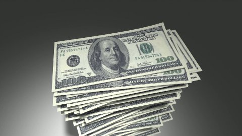 Stack of dollar bills. - stock footage