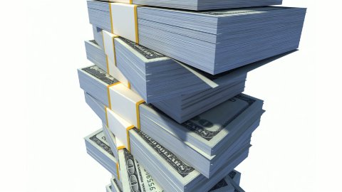 Looping Stack of Dollar Bills. - stock footage
