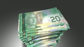 Huge stack of 20 Canadian Dollar bills. - motion graphic